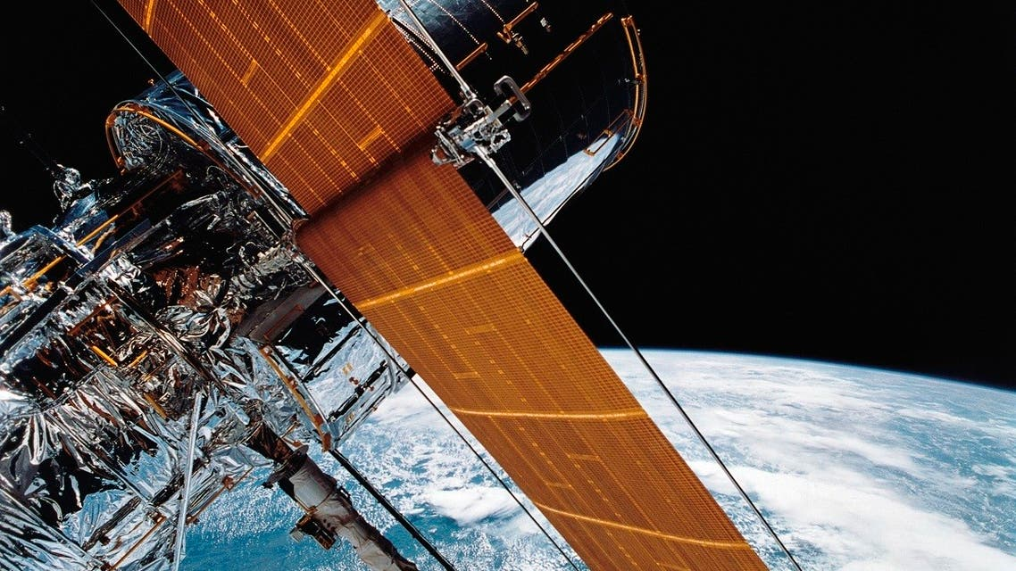 In this April 25, 1990 file photo provided by NASA, most of the giant Hubble Space Telescope can be seen as it is suspended in space by Discovery's Remote Manipulator System (RMS) following the deployment of part of its solar panels and antennae. (AP)