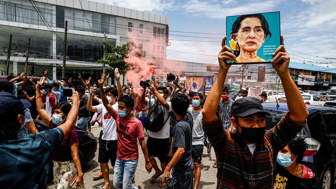 A protester holds up a painting of Myanmar's detained civilian leader Aung San Suu Kyi to mark her birthday during a demonstration against the military coup in Yangon on June 19, 2021.