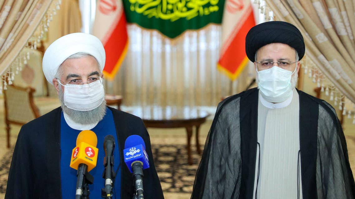 A handout picture provided by the Iranian presidency on June 19, 2021, shows outgoing President Hassan Rouhani (L) taking in part in a press conference with President-elect Ebrahim Raisi (R) during his visit to congratulate the ultraconservative cleric on winning the presidential election. Ebrahim Raisi was declared the winner Saturday of Iran's presidential election, a widely anticipated result after many political heavyweights were barred from running.