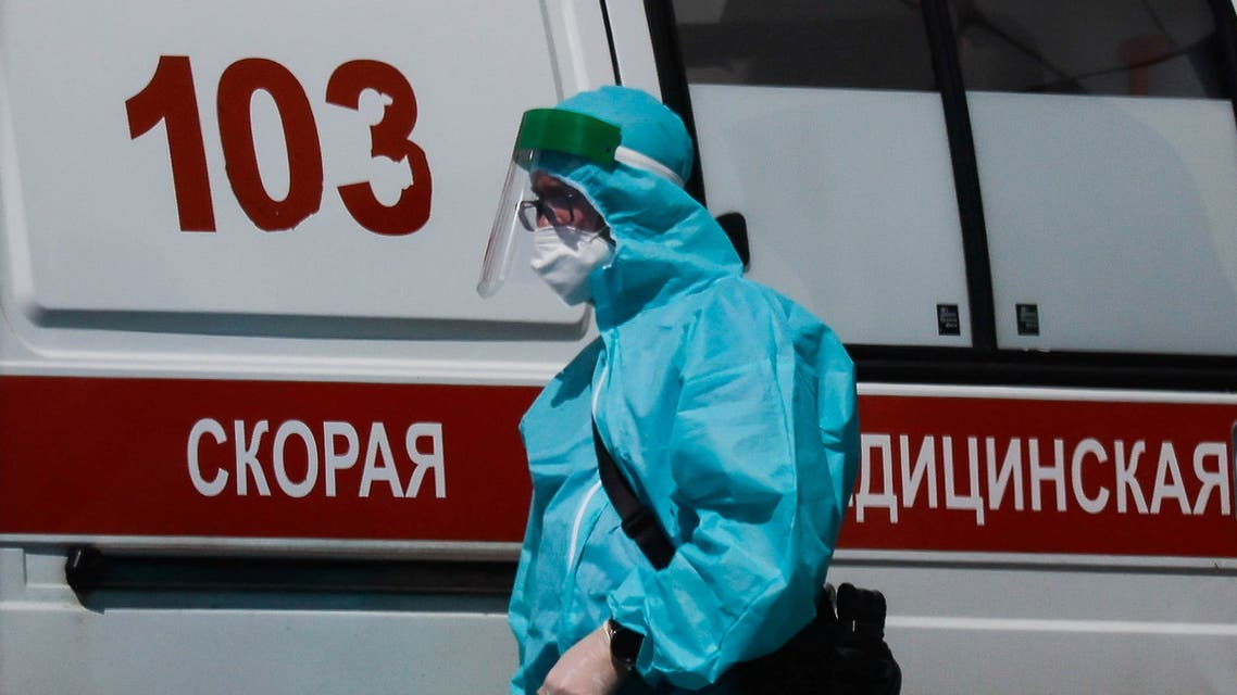 A medical specialist walks by an ambulance outside a hospital for patients infected with the coronavirus disease (COVID-19) in Moscow, Russia June 16, 2021. (Reuters)