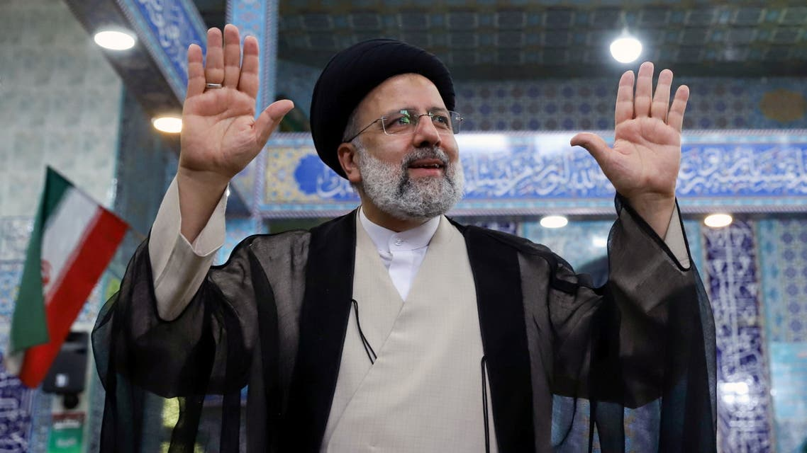 Presidential candidate Ebrahim Raisi gestures after casting his vote during presidential elections at a polling station in Tehran, Iran June 18, 2021. (Reuters)