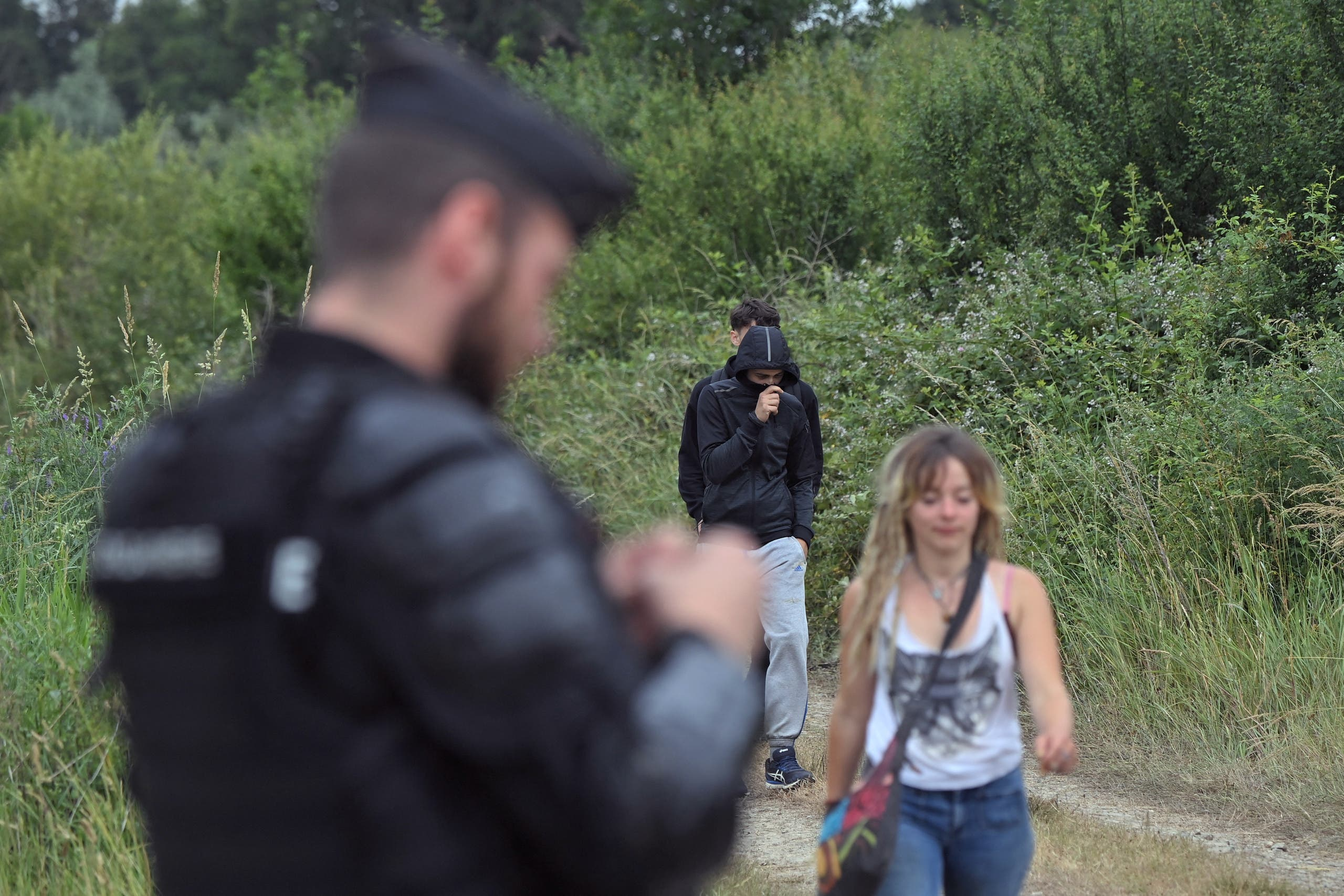 French gendarmes stand on a road, in Redon, north-western France, on June 19, 2021, as they intervene to prevent an illegal rave party, which began during the night of June 18 to June 19, 2021. (AFP)
