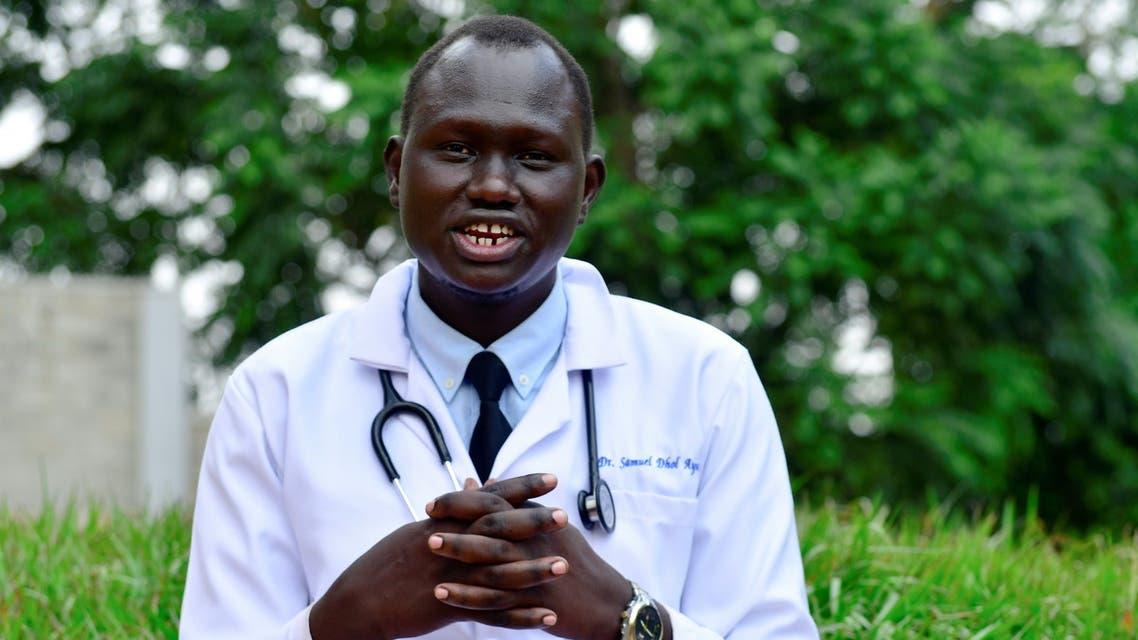 العربية Samuel Dhol Ayeun, a trainee doctor who fled from South Sudan to Uganda, poses for a photo at the Mulago National Specialised Hospital in Kampala, Uganda June 17, 2021. Picture taken June 17, 2021. REUTERS/Abubaker Lubowa