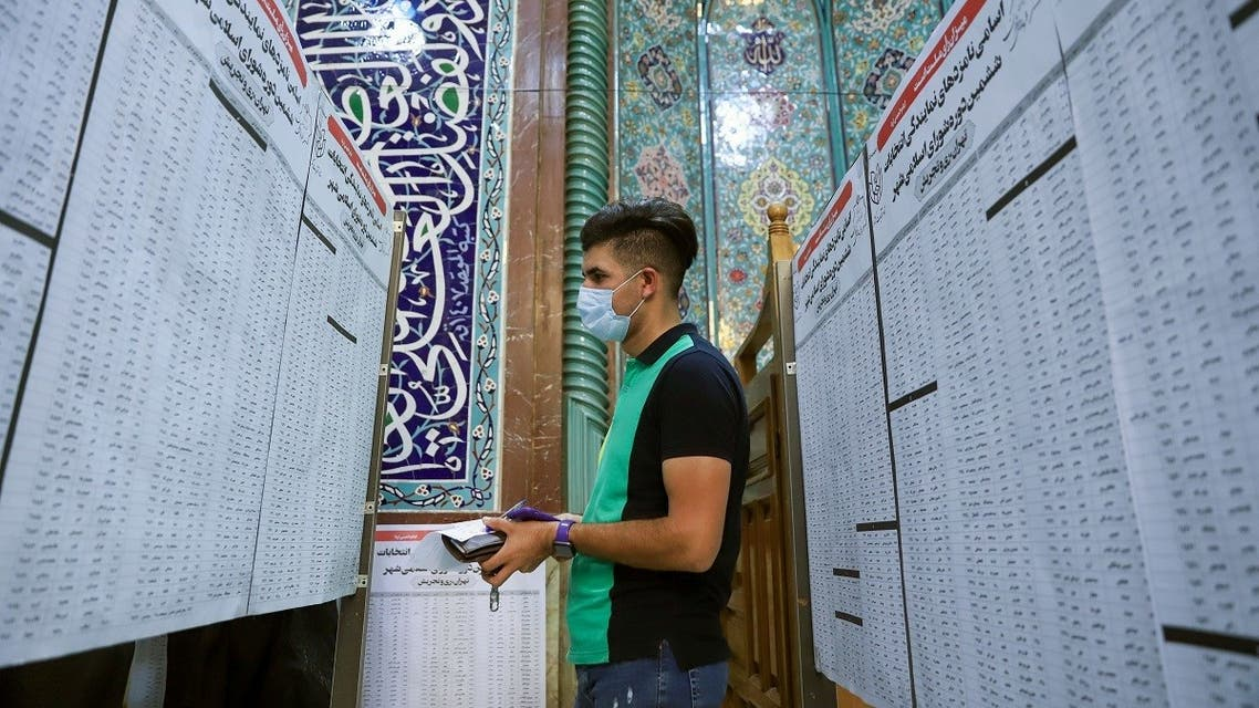 An Iranian checks the names of candidates during presidential elections at a polling station in Tehran, Iran June 18, 2021.  (Reuters)