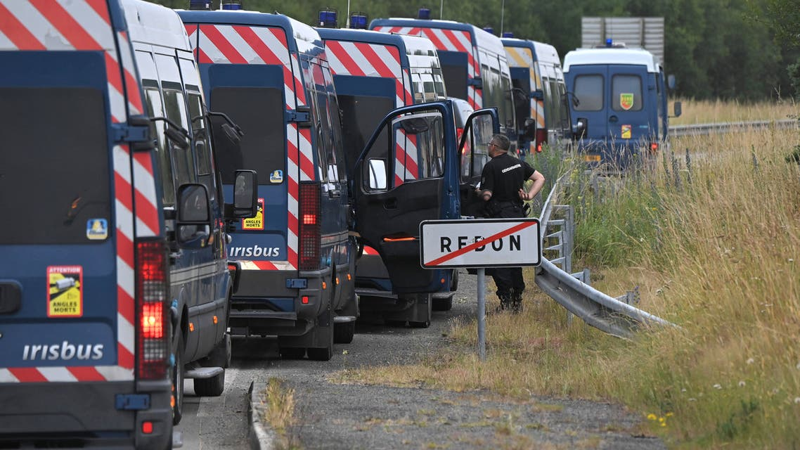 French gendarmes stand on a road, in Redon, north-western France, on June 19, 2021, as they intervene to prevent an illegal rave party, which began during the night of June 18 to June 19, 2021. Five gendarmes were injured during the intervention to disperse an illegal rave party in Redon (Ille-et-Vilaine) and a young participant of 22 years old lost a hand, announced on June 19, 2021 morning the prefect of Ille-et-Vilaine Emmanuel Berthier. The police has been confronted with violent individuals who refuse to leave the premises for several hours, he said on June 19, 2021.