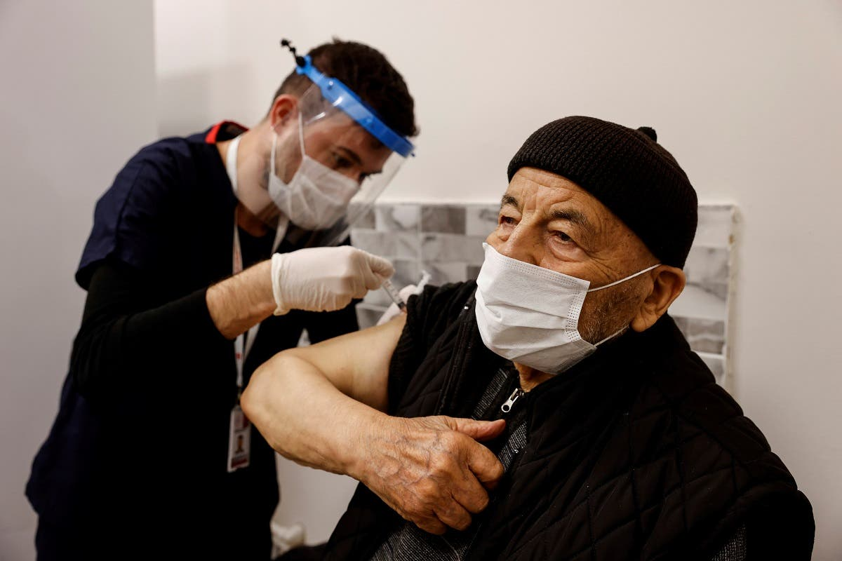 Hasan Oz receives a shot of the Sinovac's CoronaVac COVID-19 vaccine as nationwide vaccination began for seniors of 80 years old or older at Sancaktepe Education and Research Hospital, in Istanbul, Turkey, January 27, 2021. (Reuters)