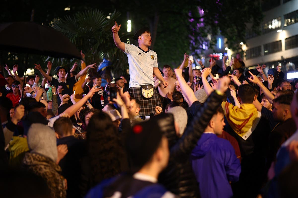 Scotland fans celebrate in London after the match. (Reuters)