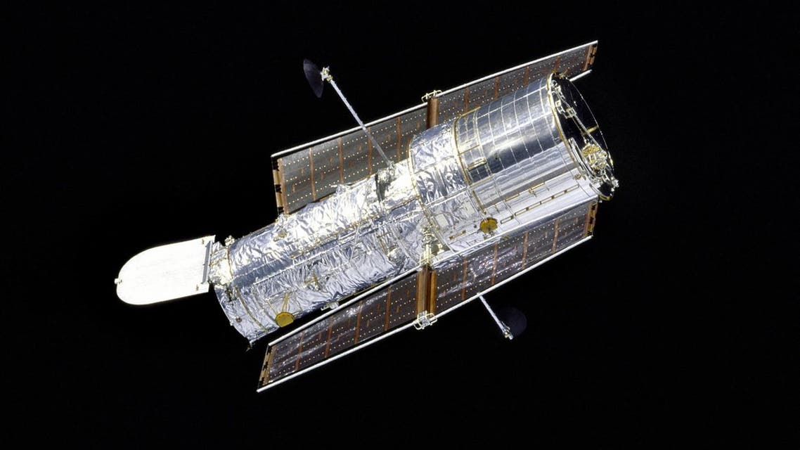 This 1997 NASA file image shows the Hubble Space Telescope as seen by the Space Shuttle Discovery as she performed a flyaround of the Hubble Space Telescope (HST) after redeployment on the second servicing mission designated HST SM-02. The silvery telescope, with its aperture door open, is sharply contrasted by the velvety blackness of space. AFP PHOTO/ NASA