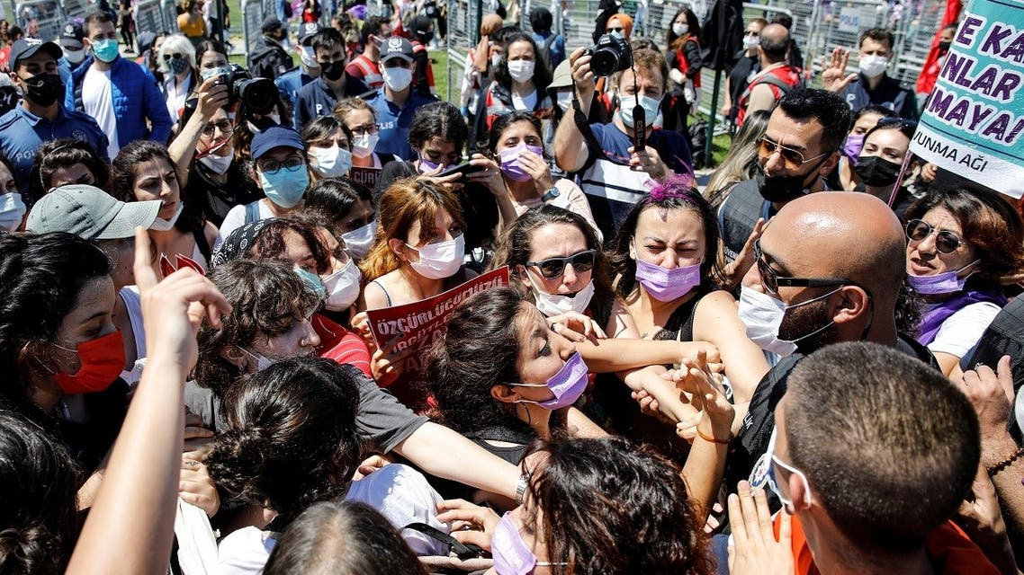 Activists scuffle with a plain-clothes police officer as they don't want to hand over a banner deemed illegal by the police, during a protest against Turkey's withdrawal from the Istanbul Convention, an international accord designed to protect women, in Istanbul, Turkey, June 19, 2021. (Reuters)