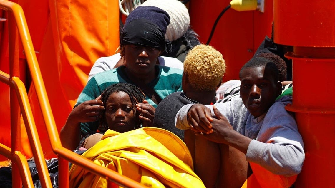 Migrants wait to disembark from a Spanish coast guard vessel, in the port of Arguineguin, on the island of Gran Canaria, Spain June 20, 2021. (Reuters/Borja Suarez)