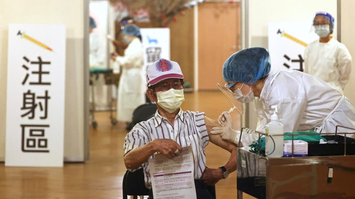 A medical worker administers a dose of the AstraZeneca vaccine against the coronavirus disease (COVID-19) to a man during a vaccination session for elderly people over 85 years old, at a Buddhist temple in New Taipei City, Taiwan, June 16, 2021. (Reuters)