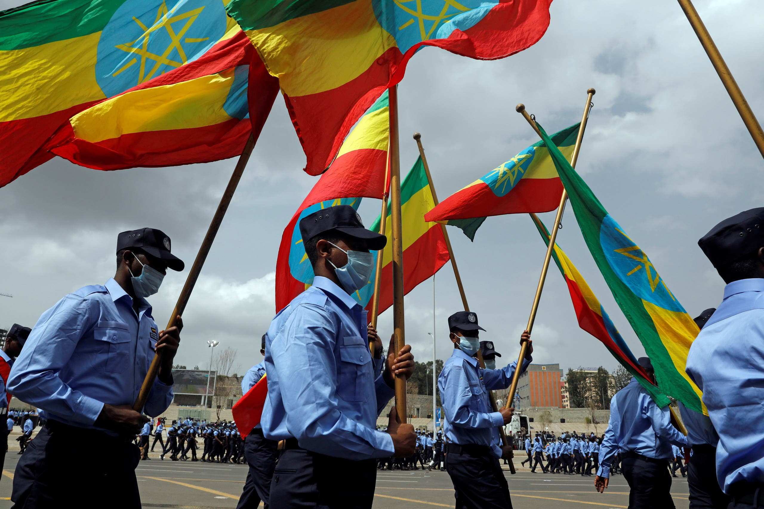 Addis Ababa police officers holding the Ethiopian national flags, take part in a parade to display their new uniforms, and their readiness for the upcoming Ethiopian parliamentary and regional elections, in Addis Ababa, Ethiopia, June 19, 2021. (File photo: Reuters)