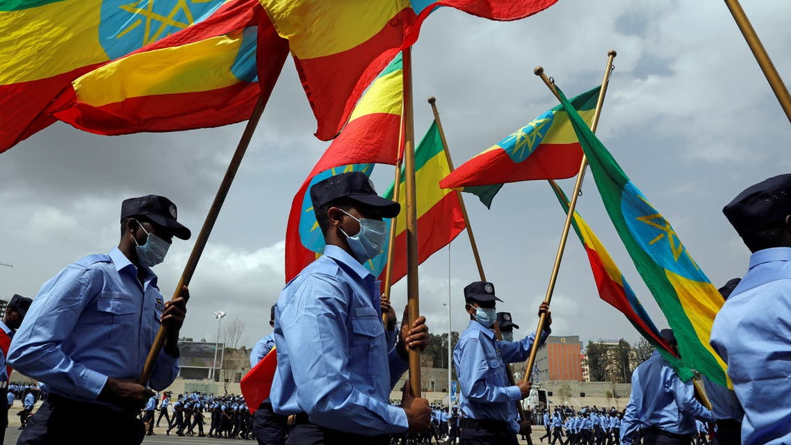 Addis Ababa police officers holding the Ethiopian national flags, take part in a parade to display their new uniforms, and their readiness for the upcoming Ethiopian parliamentary and regional elections, in Addis Ababa, Ethiopia, June 19, 2021. (Reuters)