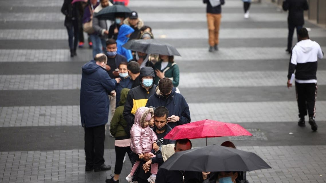 People queue outside a mass vaccination center for those aged 18 and over at the Tottenham Hotspur Stadium, amid the coronavirus pandemic, in London, UK, June 20, 2021. (Reuters/Henry Nicholls)