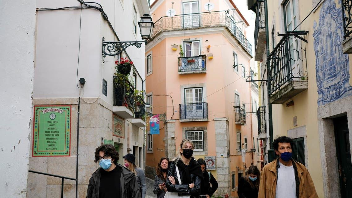 Tourists walk in Alfama neighbourhood amid the coronavirus disease (COVID-19) pandemic, in Lisbon, Portugal, March 11, 2021. (Reuters)