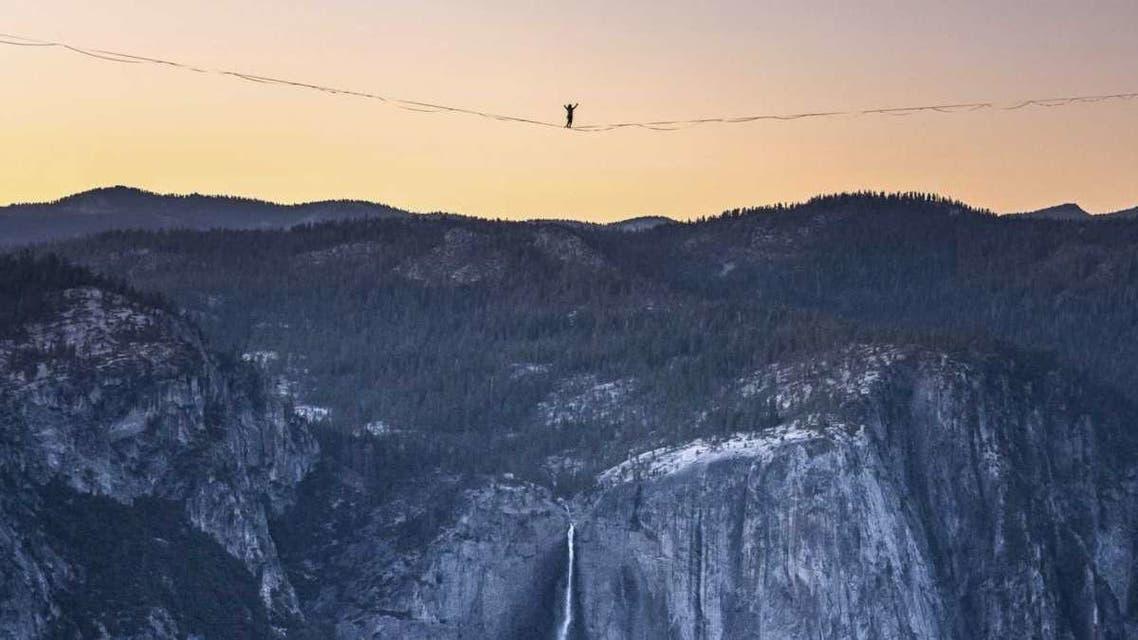 In this Saturday, June 12, 2021, photo provided by Scott Oller Films, highliner Daniel Monterrubio walks the 2,800-foot-long line off Taft Point above Yosemite Valley in Yosemite, Calif. (Scott Oller/Scott Oller Films via AP)Scott Oller/AP