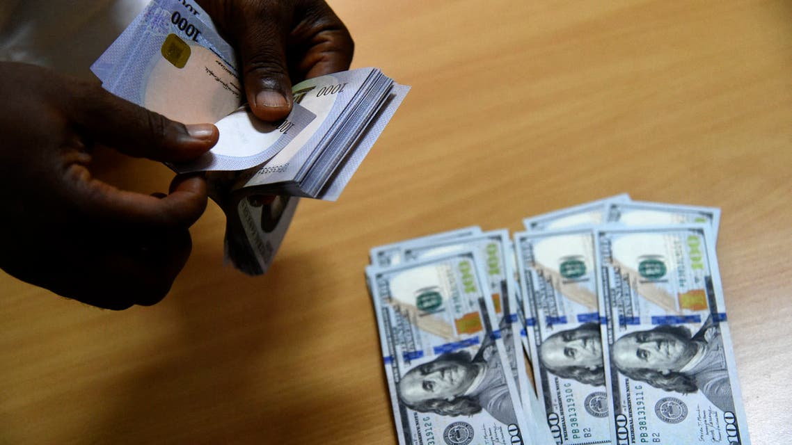 A man exchanges Nigeria's currency Naira for US dollars in Lagos, Nigeria, on April 19, 2021. (AFP)