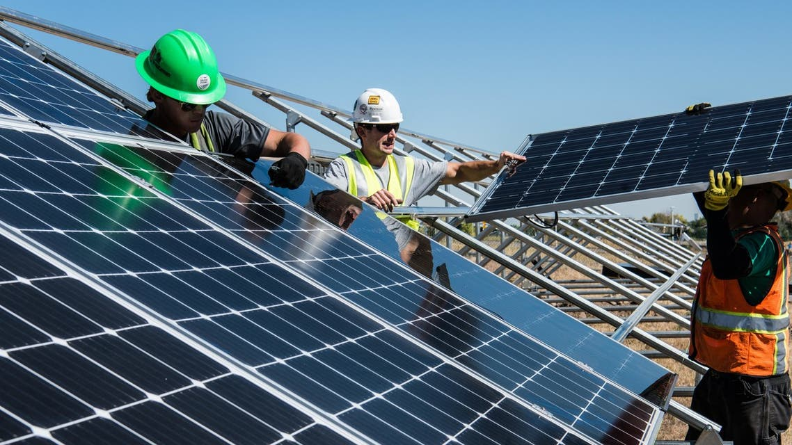 Workers putting up solar panels. (File photo: Unsplash, Science in HD)