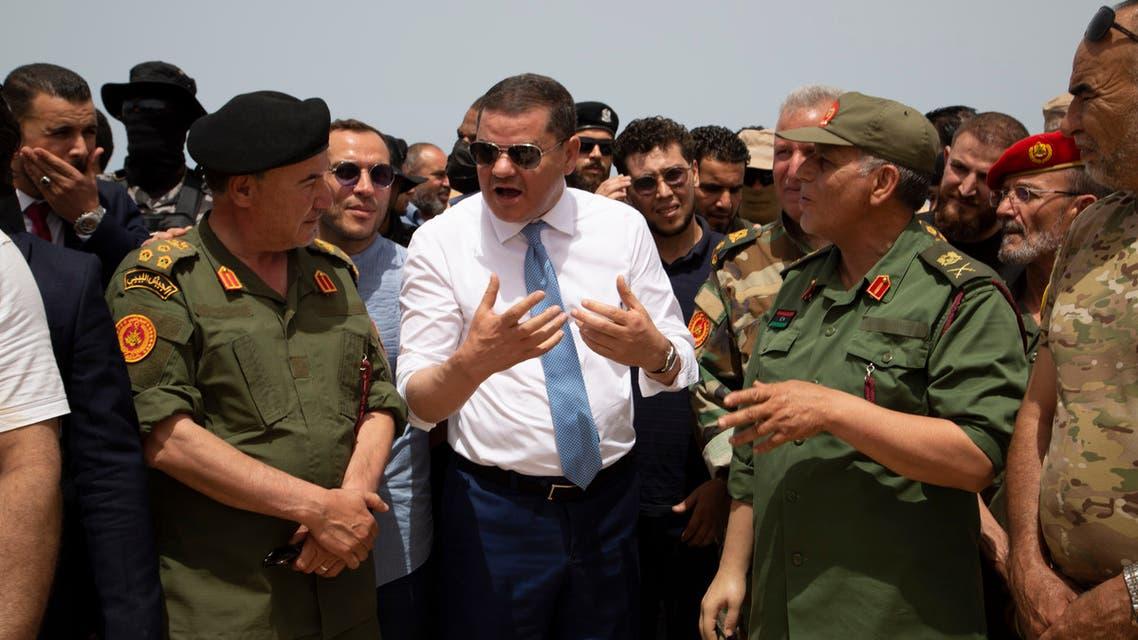 الدبيبة خلال إعادة فتح الطريق الساحلي في ليبيا (أسوشييتد برس)