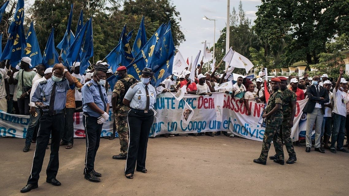 Supporters of Congo's re-elected President Denis Sassou Nguesso gather to celebrate the election results outside the headquarters of the ruling Congolese Labor Party (PCT) in Brazzaville on March 23, 2021. (Alexis Huguet/AFP)