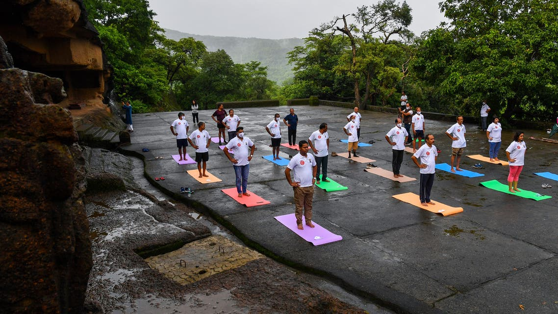 People take part in a yoga session at the Kanheri Caves on the outskirts of Mumbai on June 21, 2021, to mark International Yoga Day. (AFP)