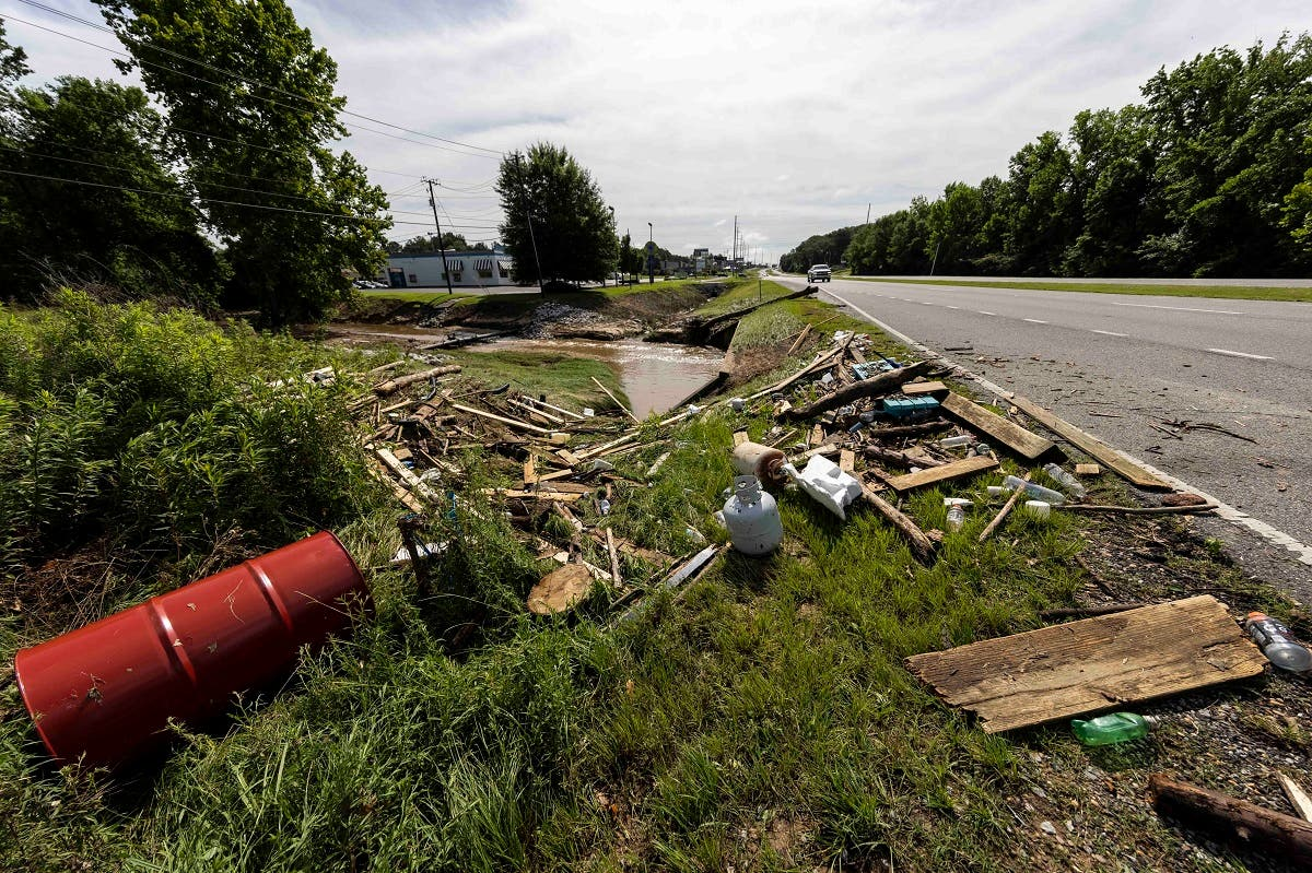 Debris sits along a creek and roadway in Northport, Alabama, Sunday, June 20, 2021. Tropical Depression Claudette has claimed 12 lives in Alabama as the storm swept across the southeastern US, causing flash flooding and spurring tornadoes that destroyed dozens of homes. (AP)