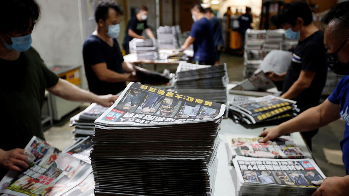 Workers prepare copies of Apple Daily newspaper at its printing facility for distribution after police raided its newsroom and arrested five executives the day before, in Hong Kong, China early June 18, 2021. (Reuters)