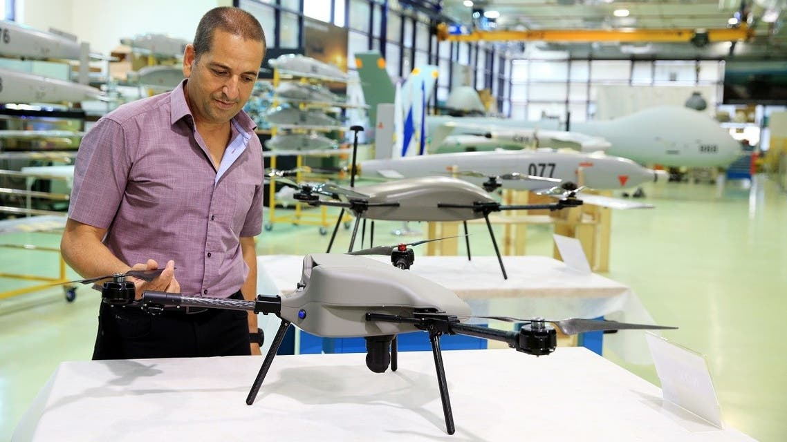 An employee stands next to an unmanned aerial vehicle (UAV) at the Elbit Systems Ltd. drone factory in Rehovot, Israel. (Reuters)