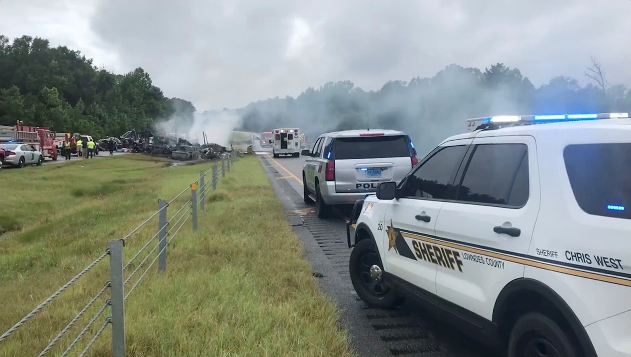 Smoke rises from the wreckage after about 18 vehicles slammed together on a rain-drenched Alabama highway during Tropical Storm Claudette, in Butler County, Alabama, US, June 19, 2021. (Reuters)