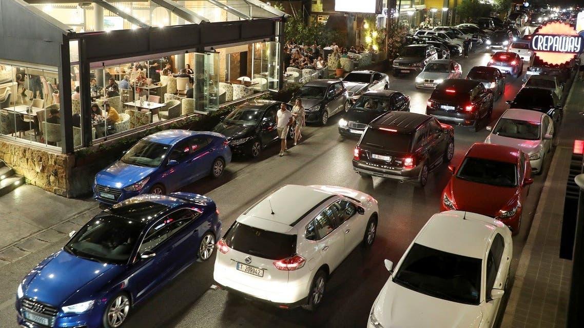 Vehicles ride past restaurants in Batroun, Lebanon June 5, 2021. (Reuters/Mohamed Azakir)