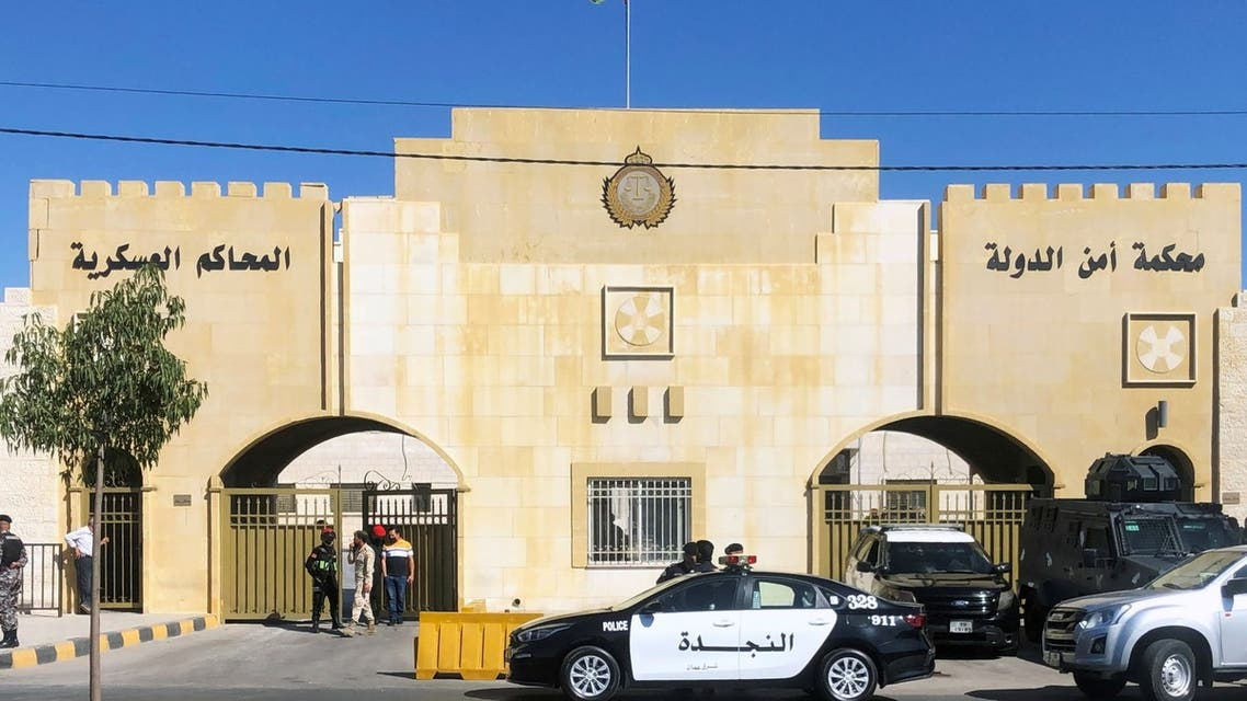 A police vehicle is parked outside the military court where the trial of former royal court chief Bassem Awadallah and a minor royal, Sherif Hassan Zaid, is set to take place in Amman, Jordan June 21, 2021. (Reuters)