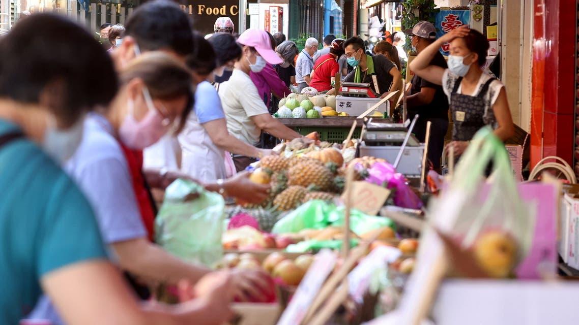 People wearing protective face masks shop at a market amid the coronavirus disease (COVID-19) pandemic, in Taipei, Taiwan, June 8, 2021. (Reuters)