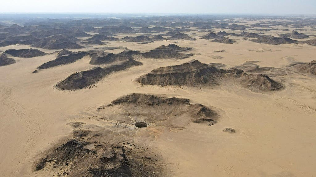 An aerial view taken on June 6, 2021 shows the Well of Barhout known as the Well of Hell in the desert of Yemen's Al-Mahra province. (AFP)