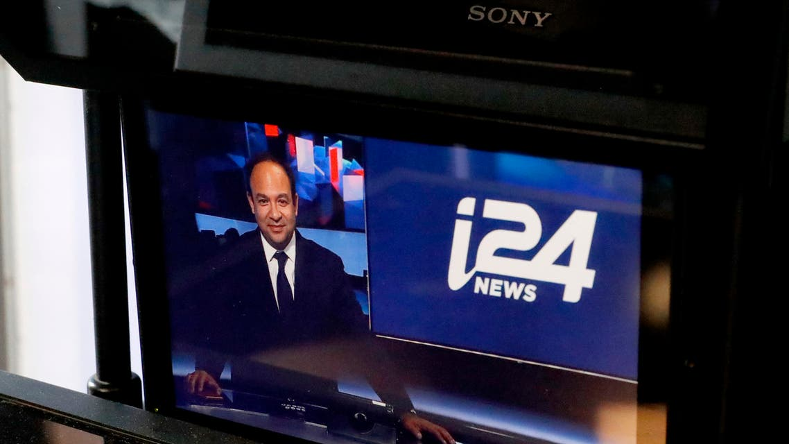 Swiss-Israeli CEO of the international television station i24 News, Frank Melloul, is pictured on a monitor at the station's headquarters in Tel Aviv's waterfront Jaffa district on October 16, 2018. The TV station said it started transmitting in English and French inside Israel itself in August 2018, after finally winning a local broadcast licence, five years after its launch. (AFP)