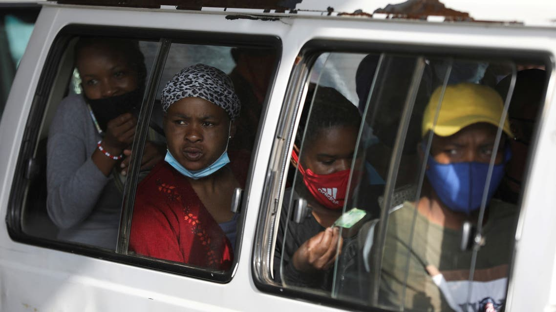FILE PHOTO: Commuters, some wearing face masks, look on through a window at the Baragwanath taxi rank, amid the coronavirus disease (COVID-19) outbreak, in Soweto, South Africa, December 29, 2020. (File Photo: Reuters)