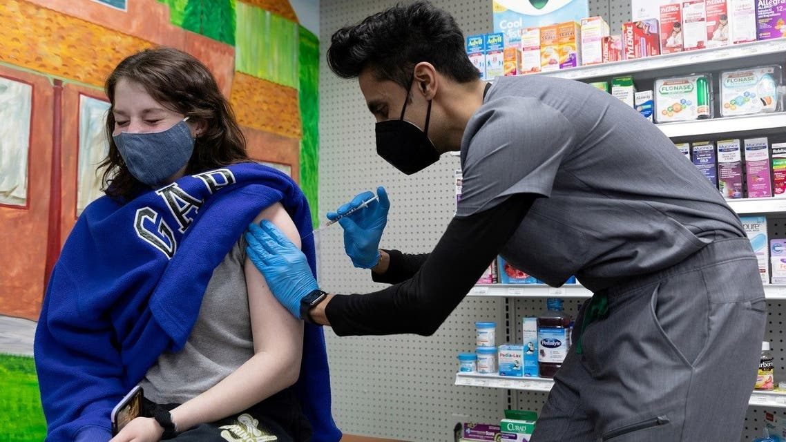 Julia Gadsby, 18, who has Lupus, receives the Pfizer-BioNTech vaccine against the coronavirus disease at Skippack Pharmacy in Schwenksville, Pennsylvania, US. (Reuters)