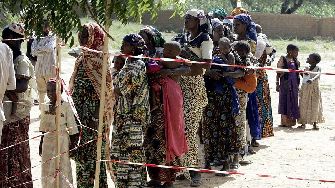 Nigerois women and their malnourished children wait in line 24 August 2005 at the entrance of a Medecins Sans Frontieres (Doctors without Borders) center in Dogo, near Zinder. (Issouf Sanogo/AFP)
