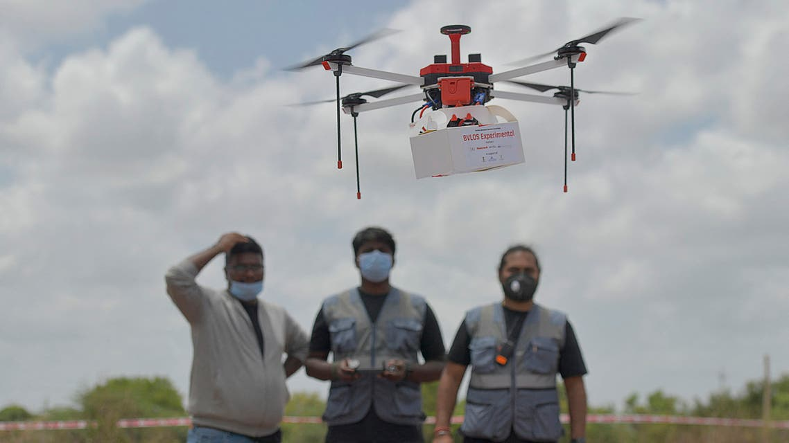 Technicians fly a drone belonging to the Throttle Aerospace Systems (TAS) which flies Beyond Visual Line of Sight (BVLOS) to deliver life saving medical supplies during a flight testing at Gauribidanur, about 80 km from Bangalore on June 21, 2021. afp