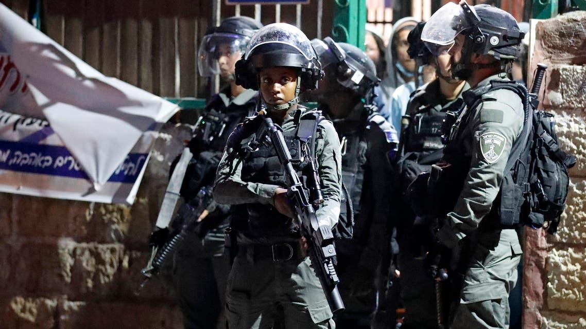 Israeli border guards stand at attention in the east Jerusalem neighbourhood of Sheikh Jarrah on June 21, 2021. (AFP)
