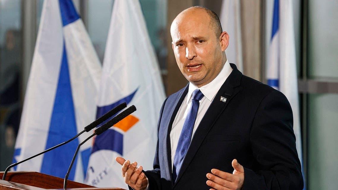 Israeli Prime Minister Naftali Bennett addresses reporters at Ben Gurion International Airport on June 22, 2021. (Jack Guez/AFP)