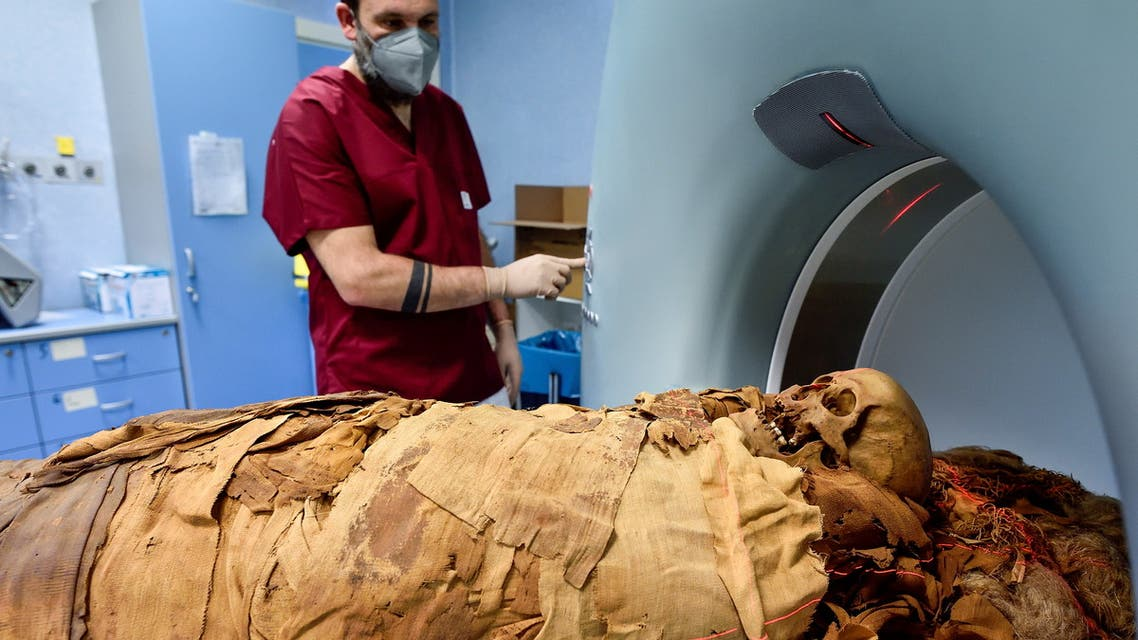 A medical radiology technician prepares a CT scan to do a radiological examination of an Egyptian mummy in order to investigate its history at the Policlinico hospital in Milan, Italy, June 21, 2021. Picture taken June 21, 2021. (Reuters)