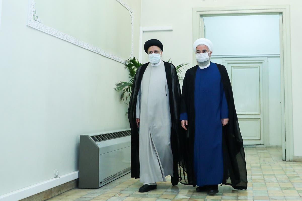 الرئيسان الإيرانيان الحالي حسن روحاني والمقبل ابراهيم رئيسي