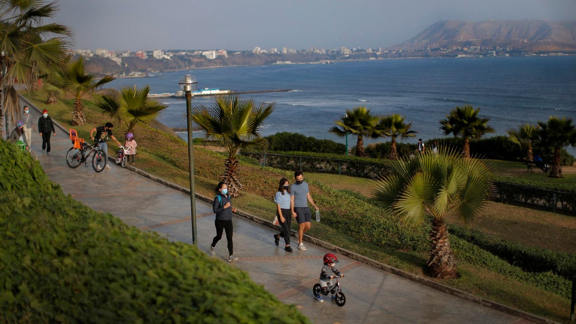People enjoy the waterfront in Lima, Peru, on June 4, 2021. (AFP)