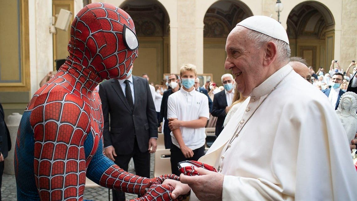 This photo taken on June 23, 2021 shows Pope Francis shaking hand with Mattia Villardita who is wearing a costume of the Spider-Man at the end of the weekly general audience on June 23, 2021 at San Damaso courtyard in The Vatican. (Handout/Vatican Media/AFP)
