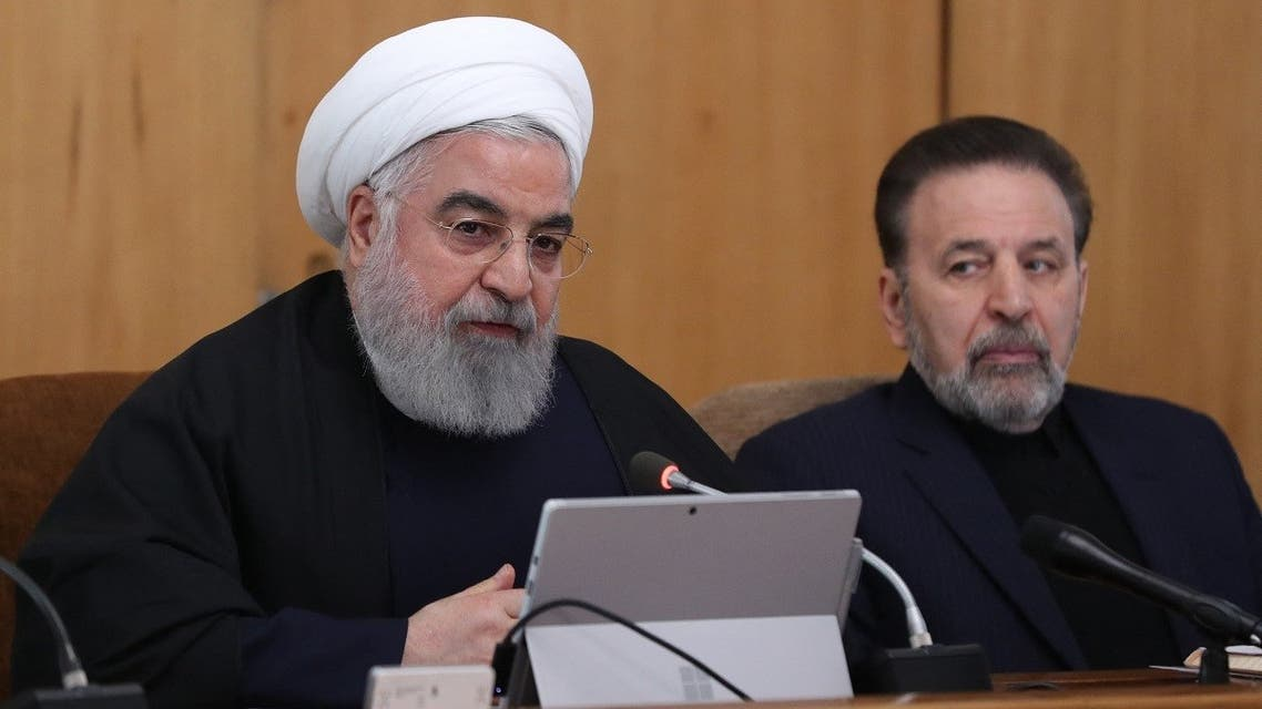A handout picture provided by the Iranian presidency shows the Islamic republic's President Hassan Rouhani (L) chairing a cabinet meeting in the presence of his chief of staff Mahmoud Vaezi in Tehran on January 8, 2020. (Iranian Presidency/AFP)