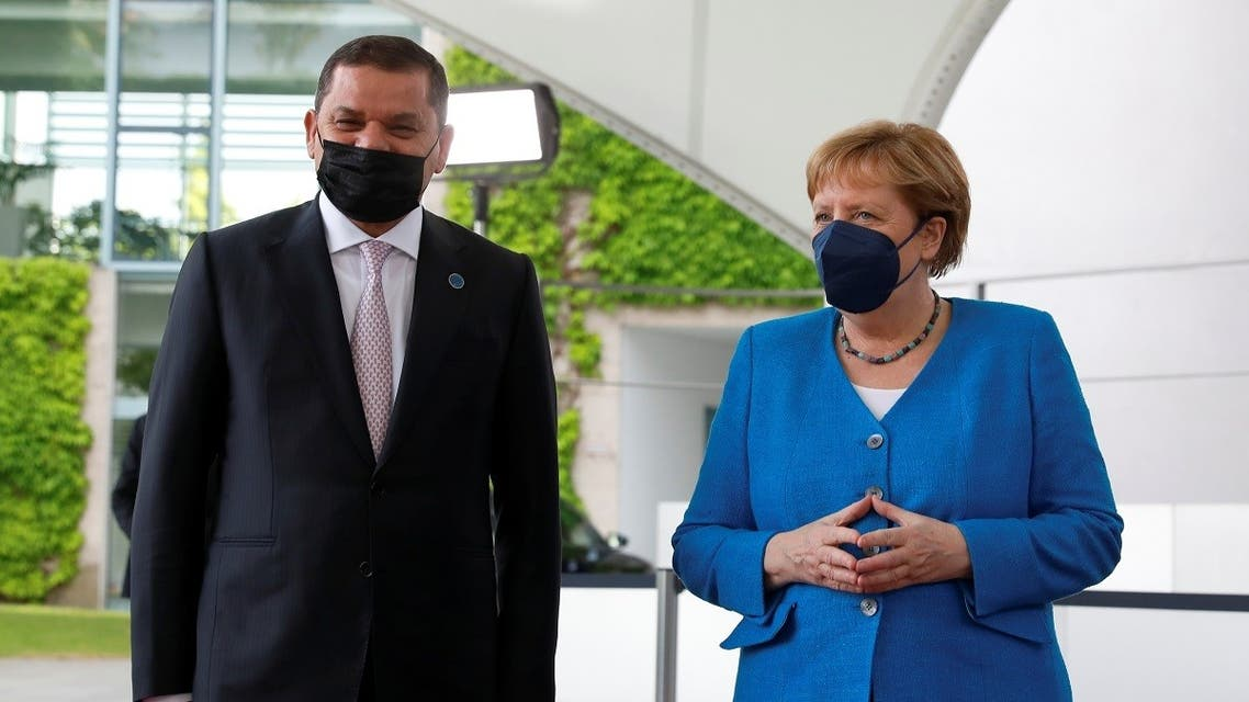 German Chancellor Angela Merkel meets with Libyan Prime Minister Abdulhamid Dbeibeh at the sidelines of the second Libya summit at the Chancellery in Berlin, Germany, June 23, 2021. (Reuters)