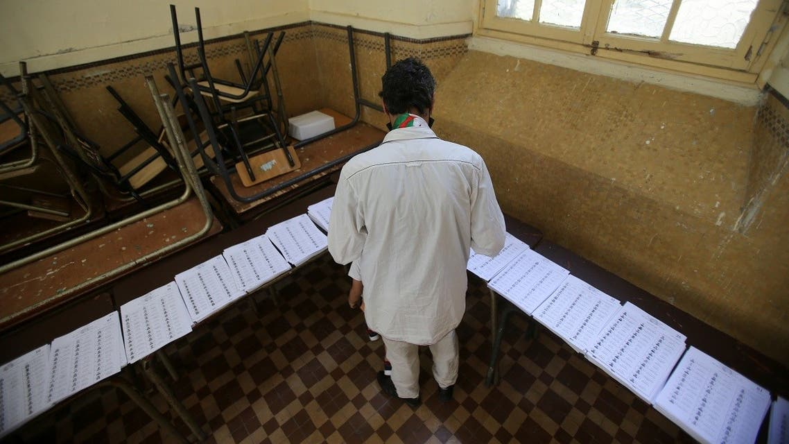 A voter looks at ballots at a polling station during the parliamentary election, in Algiers, Algeria June 12, 2021. (AFP)