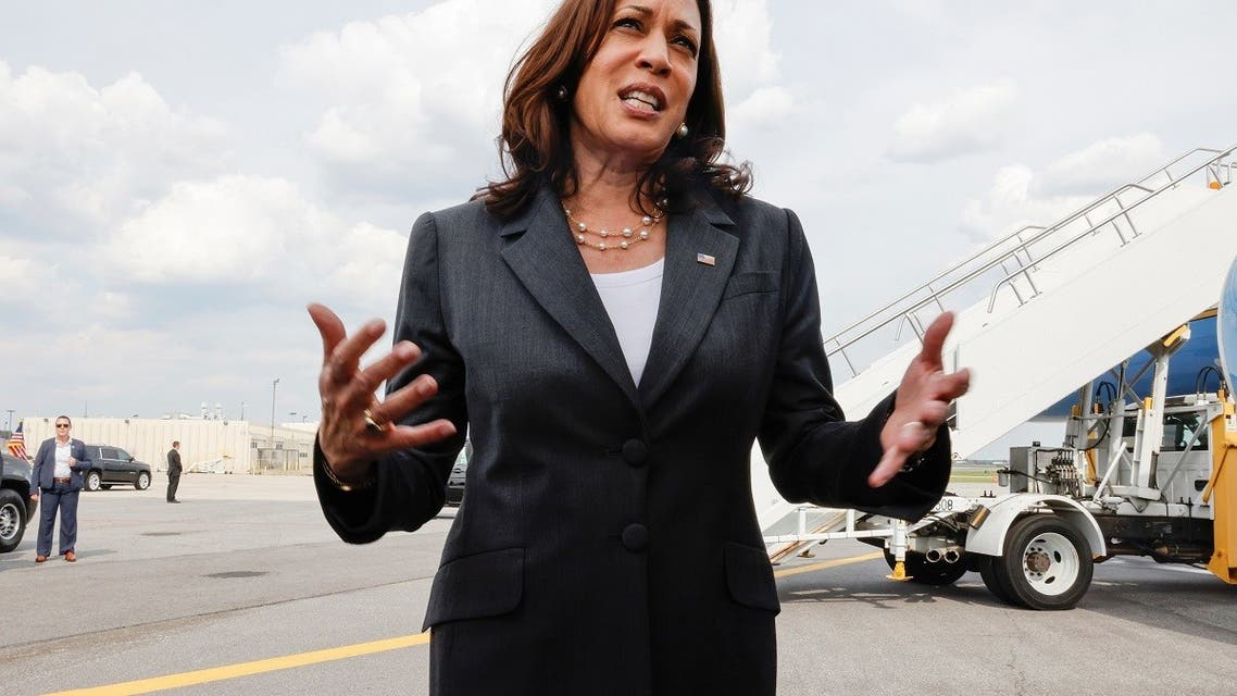 Vice President Kamala Harris talks to reporters on the tarmac before boarding her plane to depart from Atlanta, June 18, 2021. (Reuters)
