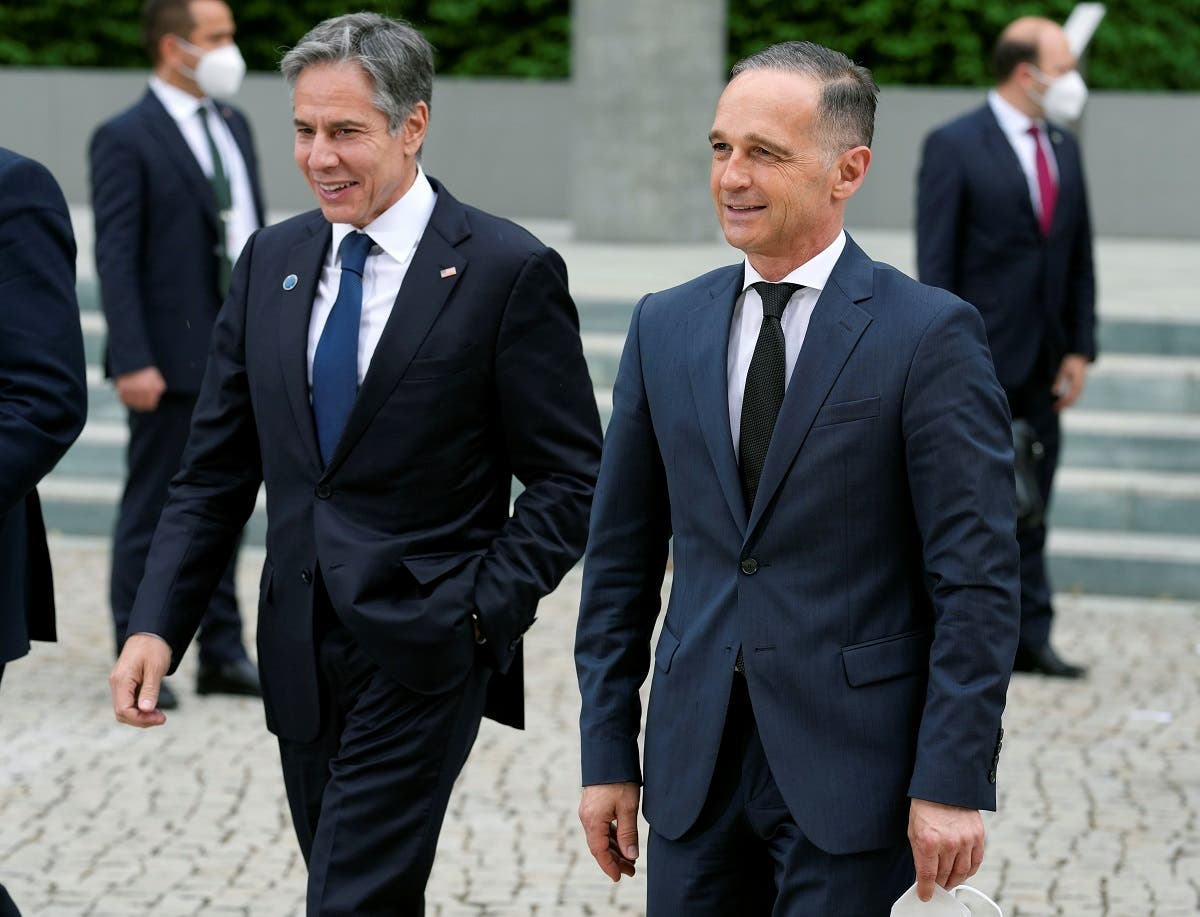 German Foreign Minister Heiko Maas and US Secretary of State Antony Blinken walk after posing for a group photo during the 'Second Berlin Conference on Libya' at the foreign office in Berlin, Germany, June 23, 2021. (Michael Sohn/Pool via Reuters)