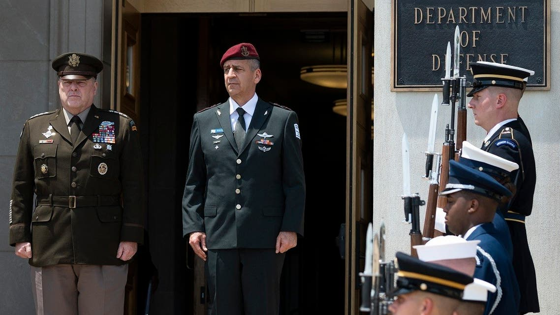 Chairman of the Joint Chiefs of Staff Army General Mark Milley (L) hosts an enhanced honor cordon for the Israeli Chief of Defense LTG Aviv Kohavi at the Pentagon, June 21, 2021. (AFP)